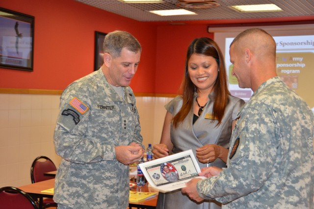 IMCOM Commander, Lt. Gen. Michael Ferriter and Command Sgt. Maj. Earl Rice visited the Vicenza Military Community Aug. 14. They visited numerous facilities recognizing exemplary employees and spoke to employees at a Town Hall meeting.