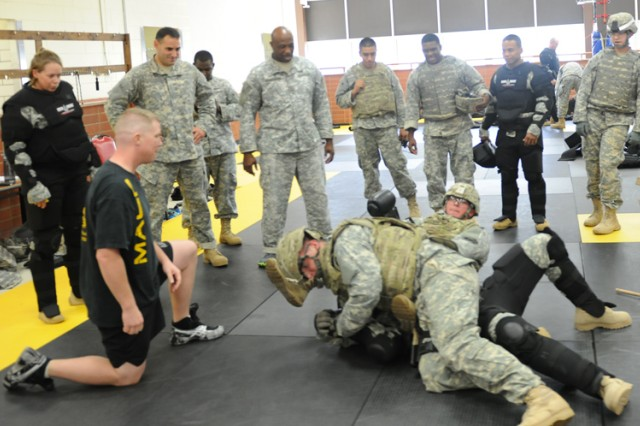 Level II Combatives students wrestle a suspect to the ground Aug. 30 as part of the 3rd Chemical Bridage's training at Fort Leonard Wood. The training elevates Soldiers' skills in combatives with more physical contact and is less restrictive than Level I training.