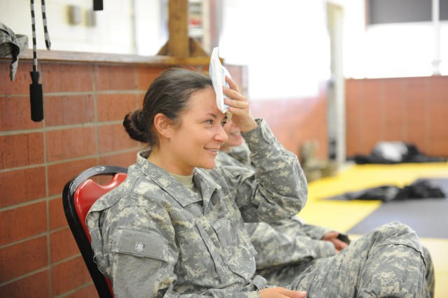 Sgt 1st Class Rosa Trujillo, Company D, 2nd Battalion^10th Infantry Regiment, ices down after a punch to the forehead during Army Level II Combatives at Fort Leonard Wood, Mo., on Aug. 30. Trujillo was part of a two-week class on combatives conducted by the 3rd Chemical Brigade.