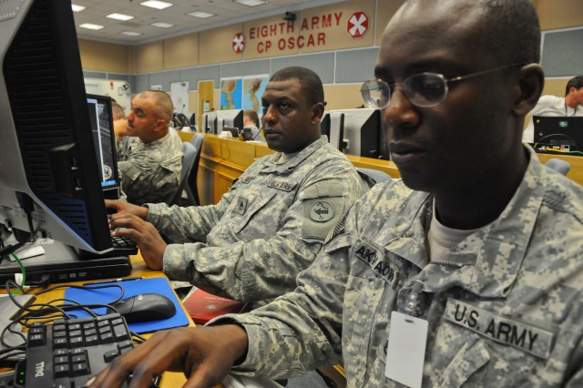 Staff Sgt. Andre Gary, a signal support noncommissioned officer, and Staff Sgt. Jackson Akwaowo, a personnel noncommissioned officer, both with the U.S. Army Pacific Contingency Command Post, prepare for exercise Ulchi Freedom Guardian in the Republic of Korea, Aug 16, 2012.  The U.S. Army Pacific Contingency Command Post consists of more than 90 personnel with the specific skills to provide U.S. Army Pacific with a forward command post capability, specifically focused on small-scale contingencies such as supporting humanitarian assistance, disaster relief and peace operations.  The CCP can tailor personnel and equipment to fit the mission with a team as small as seven, to as many as 120 service members if augmented.