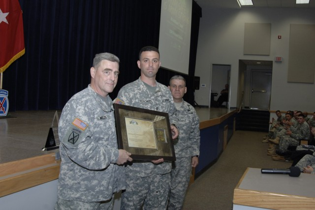 Maj. Gen. Mark A. Milley, Fort Drum and 10th Mountain Division (LI) commander, presents Chief Warrant Officer 2 Mark Foschetti with the Army Aviation Broken Wing award during Safety Stand Down Day.