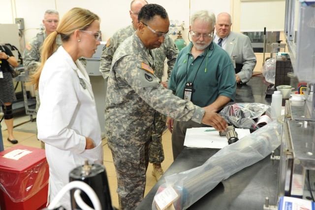 """""""We have lots of capabilities in the chemical lab that people don't know about,"""" chemist Linsay McCall said during General Dennis L. Via's first visit to Corpus Christi Army Depot. GEN Via believes that CCAD's capabilities are a strength at Department of Defense that should be utilized throughout the joint forces."""