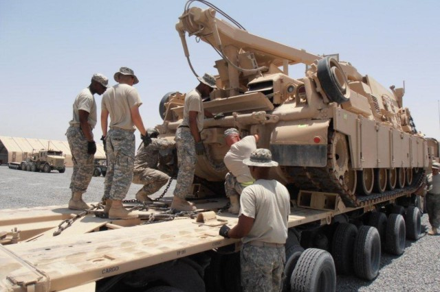 Members of the 1462nd Transportation Company recently trained soldiers from 3rd Infantry Division and Tennessee Army National Guard's 230th Engineer Battalion, on the M1070 Heavy Equipment Transporter, or HET, during an eight day, 80 hour course held at Camp Arifjan. (Photo by Sgt. Kenneth  Fahnestock, 1462nd TC)