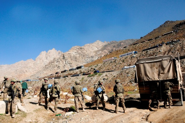 Soldiers assigned to 10th Sustainment Brigade work together to load a truck with supplies delivered near the Salang tunnel, Afghanistan. The supplies were delivered by a low-cost, low-altitude parachute drop -- the first ever near the tunnel.