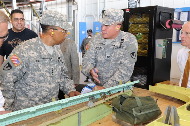Gen. Dennis L. Via, Commander of Army Materiel Command discusses Black Hawk recapitalization with Corpus Christi Army Depot Commander Christopher B. Carlile during his first visit to CCAD. CCAD is breaking records in recapitalizing Black Hawks this year.
