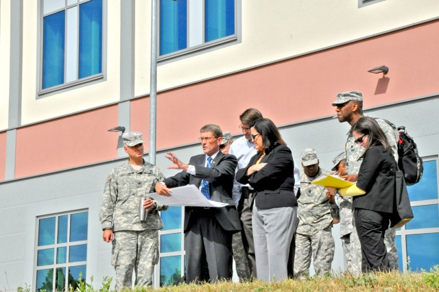 Roger Gerber, director of U.S. Army Garrison Wiesbaden's Transformation and Stationing Management Office, describes the many projects under way on Clay Kaserne to the Honorable Katherine Hammack, assistant secretary of the Army for Installations, Energy and the Environment, as Col. David Carstens (left), USAG Wiesbaden commander, and other leaders listen.
