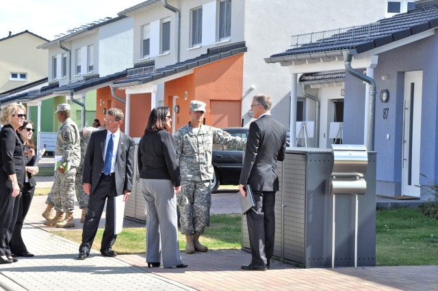 U.S. Army Garrison Wiesbaden housing chief Donald Meyer (right) talks about the standards of the new Newman Village housing area with the Honorable Katherine Hammack, assistant secretary of the Army for Installations, Energy and the Environment during her visit to Wiesbaden Sept. 6.
