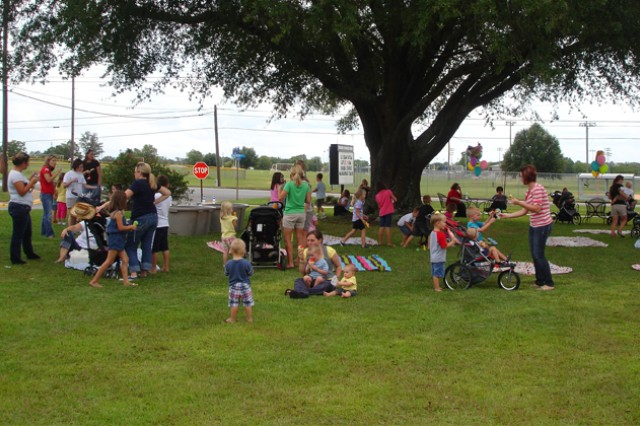 The shade of the Bowden Terrace oak tree provides relief from the heat at last year's Ice Cream Social as Soldiers and their Families meet neighbors.