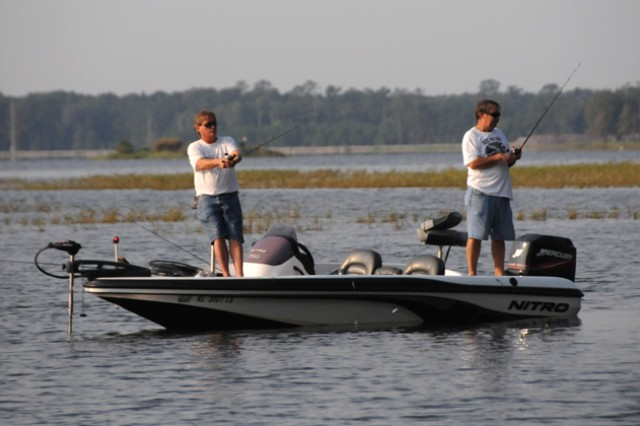 Two men fish from their boat as they compete during the 2-Man Buddy Bass Tournament in 2010.