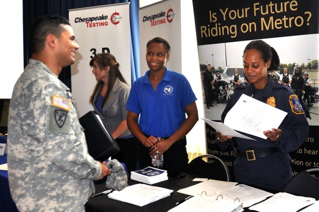 From left, Sgt. 1st Class Eduardo Peraza of the U.S. Army Test and Evaluation Command chats with Human Resources Representative Chezda Jones and Officer Doniese Collins of the D.C. Metro Transit Police during the Veterans Job Fair and Expo at the APG North (Aberdeen) recreation center Aug. 22. Forty-five local, regional and national employers drew more than 200 job seekers to the event.