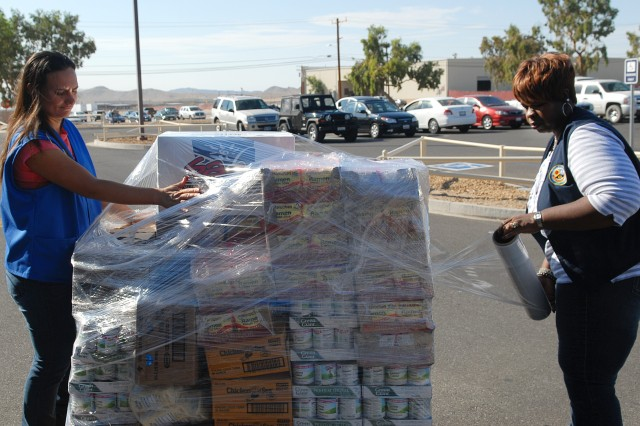 Staff from the Commissary at the National Training Center and Fort Irwin wrap a pallet of food destined for Desert Manna in Barstow, Calif. The donated food is part of the Feds Feed Families campaign.