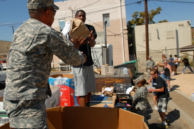 Command Sgt. Maj. Dale Perez and Spc. Ronnie Brooks took the lead during the unloading of 6,500 pounds of donated food in Barstow, Calif., Sept. 4. The food was given to Desert Manna, a non-profit organization that feeds up to 10 percent of Barstow's population of 25,000 per month.
