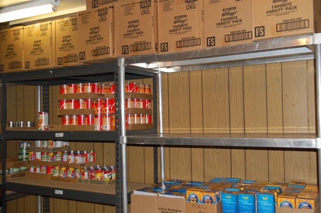 These shelves at Desert Manna will not remain empty long, since a 6,500 pound food donation was made by the National Training Center and Fort Irwin community, Sept. 4.