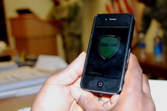 A SHARP student uses a smartphone to locate the free app Life Armor.  Life Armor is a comprehensive learning and self-development tool to assist service members with common mental and behavioral health concerns. Sleep, depression, relationship issues and post-traumatic stress are a few of the 17 topics listed.