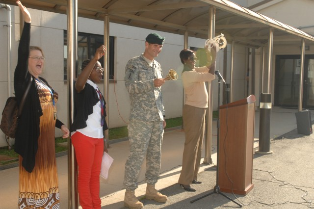 Col. Darin S. Conkright, United States Army Garrison Humphreys Commander and Joyce M. Diggs, the principal of Humphreys American School (right) ring a bell to signal the beginning of the new school season.