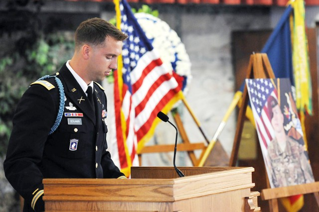 Capt. Chris Gasperini, 2nd-503rd Infantry rear detachment commander, eulogizes Spc. James A. Justice during a memorial ceremony for three fallen Sky Soldiers at the Caserma Ederle post chapel in Vicenza, Italy, Sept. 6.