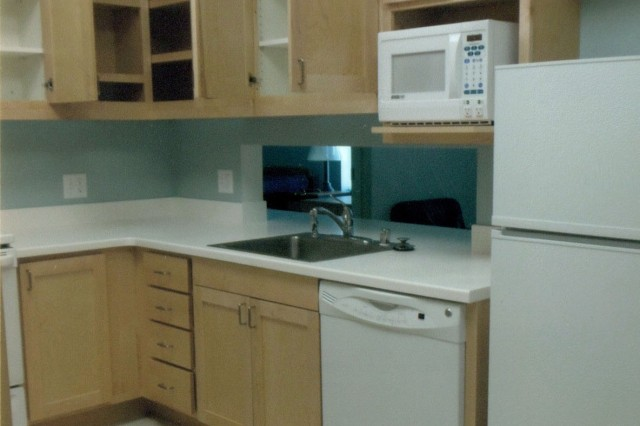 Kitchen - BEFORE The Warrior Transition Battalion barracks rooms have modern facilities although it is usually the responsibility of the Soldiers to provide necessary utensils and supplies.  (Courtesy photo)