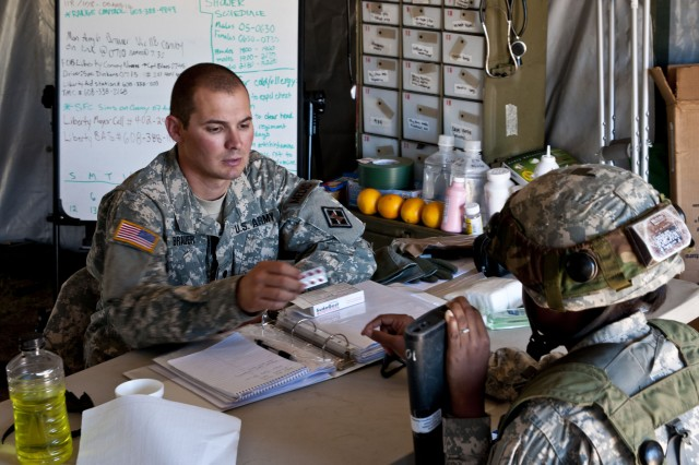 Spc. Blake A. Brauer, a medic with the 926th Engineer Battalion Headquarters Company out of Birmingham, Ala., assists a Soldier experiencing allergy symptoms during Combat Support Training Exercise 2012, Aug. 6, 2012, at Fort McCoy, Wis.