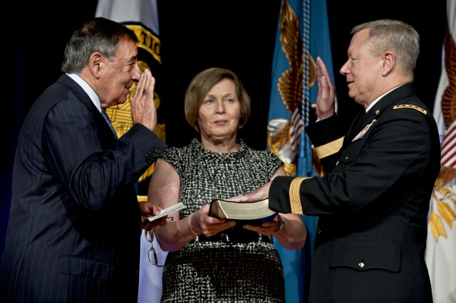 Defense Secretary Leon E. Panetta swears in Army Lt. Gen. Frank J. Grass as National Guard Bureau chief during a change-of-responsibility ceremony at the Pentagon, Sept. 7, 2012. Grass, who received his fouth star during the event, replaced Air Force Gen. Craig R. McKinley.