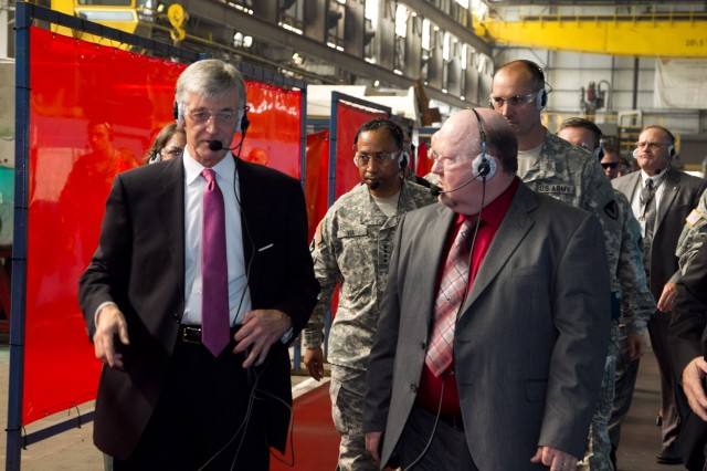 Secretary of the Army John McHugh, left, discusses Anniston Army Depot's welding capabilities with Ed Morris, process optimization manager for the depot's Combat Vehicle Value Stream, during his Sept. 7, 2012, tour of the installation. Also pictured in the photograph are Gen. Dennis Via, commanding general of Army Materiel Command and Col. Brent Bolander, the depot's commander.