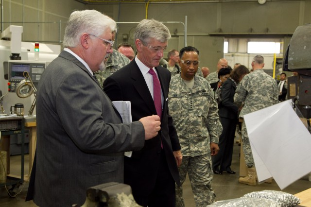 Joe Lackey, chief of Anniston Army Depot's Manufacturing Division, shows Secretary of the Army John McHugh some of the machinery used by the installation to manufacture parts during McHugh's tour of the installation, Sept. 7, 2012. Also pictured in the photograph is Gen. Dennis Via, commanding general of Army Materiel Command.