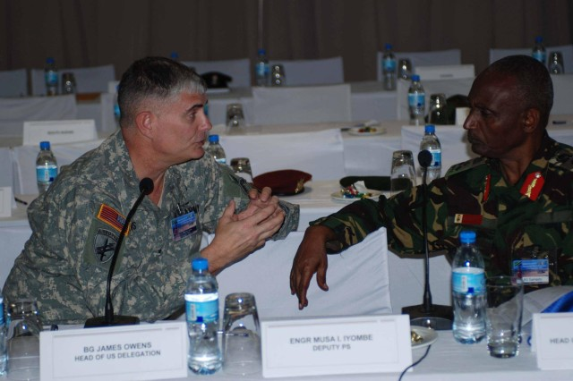 (Left) Musa Iyombe, the deputy principal secretary for the Ministry of Defence and Brig. Gen. James Owens, deputy commander, U.S. Army Africa attend Eastern Accord 2012 Counter Violet Extreme Exercise. Eastern Accord is designed to help U.S. and East African participants improve their capability to respond to regional security threats posed by Violent Extremist Groups and to more effectively counter the associated Violent Extremist Ideology.