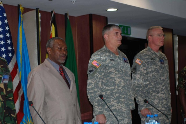 (Left to right) Engineer Mussa Iyombe, the deputy principal secretary for the Ministry of Defence; Brig. Gen. James Owens, deputy commander, U.S. Army Africa; and Col. William Ward, 110th Maneuver Enhancement Brigade, Missouri Army National Guard, officiate the Eastern Accord 2012 Counter Violet Extreme Exercise opening ceremony. Eastern Accord is designed to help U.S. and East African participants improve their capability to respond to regional security threats posed by Violent Extremist Groups and to more effectively counter the associated Violent Extremist Ideology.
