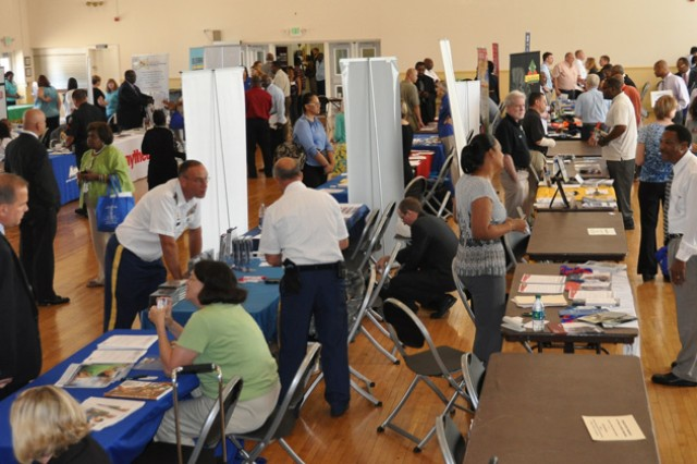 Job seekers visit displays and chat with representatives from 45 organizations during a Veterans Job Fair and Expo held in Maryland.