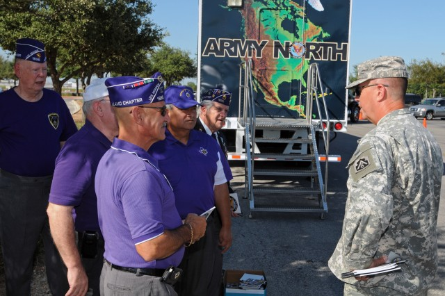 SAN ANTONIO - Sgt. Maj. Eric Lobsinger, chief public affairs noncommissioned officer, U.S. Army North, meets with members of the Alamo Chapter 1836, Military Order of the Purple Heart, and talks to them about the importance of Army North and its missions prior to a San Antonio Silver Stars basketball game Sept. 7. The Silver Stars, part of the Woman's National Basketball Association, were honoring military members, both past and present, with a military appreciation night. (U.S. Army photo by Staff Sgt. Keith Anderson, Army North PAO)