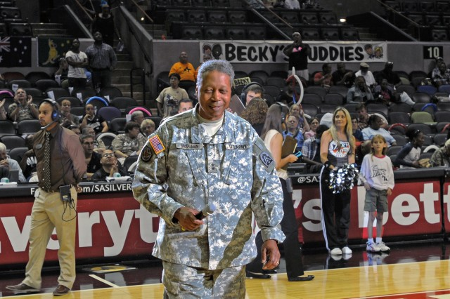 SAN ANTONIO - Maj. Gen. Adolph McQueen Jr., deputy commanding general for support, U.S. Army North, walks to center court prior to making remarks at the Sept. 7 San Antonio Silver Stars basketball game.  The Silver Stars, part of the Woman's National Basketball Association, honored military members, both past and present, with a military appreciation night. (U.S. Army photo by Staff Sgt. Corey Baltos, Army North PAO)