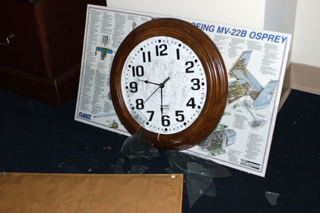A clock, frozen at the time of impact, inside the Pentagon. Shortly after 8 a.m., Sept. 11, 2001, five men hijacked American Airlines Flight 77, a Boeing 757-200, from Dulles International Airport just outside Washington, D.C. About 9:30 a.m., they flew the aircraft and its 64 passengers into the side of the Pentagon.