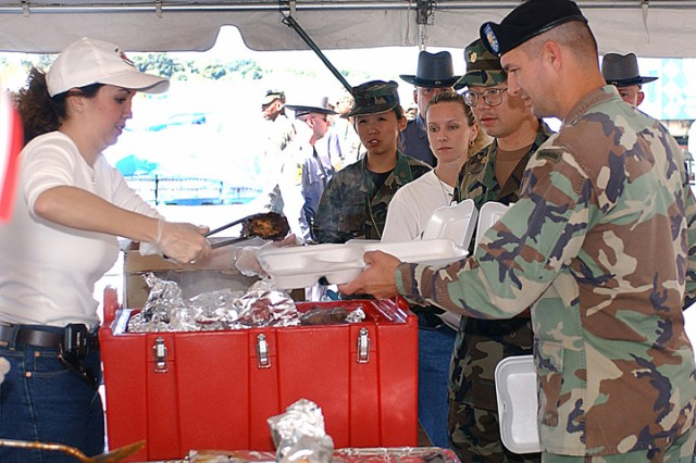During the recovery operation, military and civilian personnel receive lunch outside the Pentagon, Sept. 16, 2001. On Sept. 11, 2001, a hijacked airliner struck the Pentagon causing extensive damage to the building.