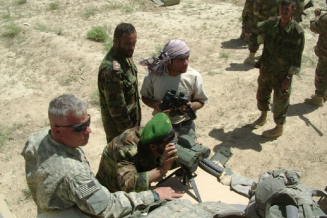 Now-Capt. Lou Delli-Pizzi of the New York National Guard shows Afghan National Army soldiers how to use a range finder at Hasan Karez, Zabul Province, Afghanistan, in June 2008.