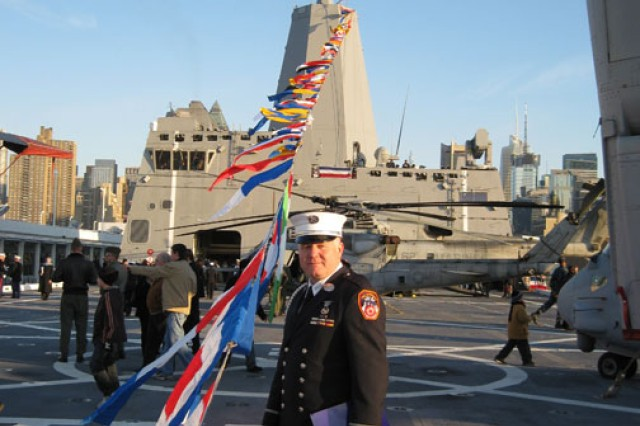 New York City Fire Department lieutenant and New York National Guard Capt. Thor Johannessen poses in front of the USS New York at its commissioning in New York City, Nov. 7, 2009.