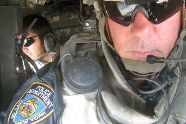 Now-Capt. Lou Delli-Pizzi of the New York National Guard conducts a mounted patrol in Kandahar Province, Afghanistan, Sept. 11, 2008, while wearing his New York City Police Department raid jacket over his Army uniform.