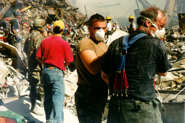 """Soldiers from the New York National Guard's """"Fighting"""" 69th Infantry Division, which is based in midtown Manhattan, help with the response to 9/11 at the World Trade Center in New York City after terrorists crashed two airplanes into the twin towers."""