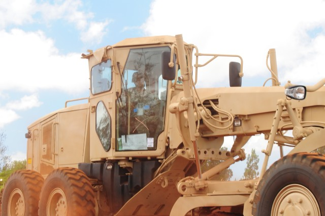 Spc. Daniel Martin, Heavy Equipment Operator, 561st Engineer Company, 84th Engineer Battalion, 130th Engineer Brigade operates the Caterpillar 120M Motorized Grader during the Operator New Equipment Training at the Engineer Training Area on East Range, Schofield Barracks.