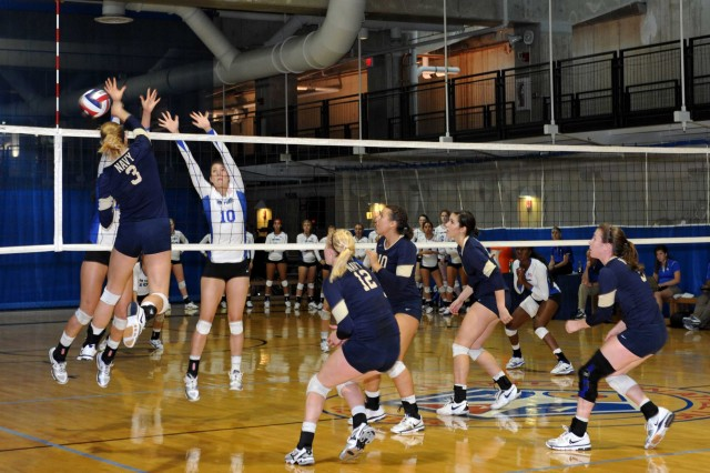 Naval Academy freshman Olivia Yeager (3) attempts a spike during one of five sets against the Air Force Academy. Navy won the first two sets, 25-13 and 25-14, but dropped the next two and the tie-breaker with Air Force taking the match 25-17, 25-17 and 15-12. Army, Navy, Air Force, the Citadel and the University of Denver participated in the first-ever service academy challenge hosted by the Pentagon, Sept. 7-8, 2012.