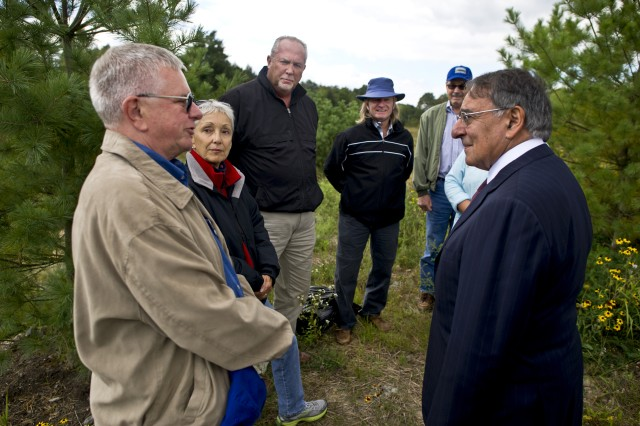 On the eve of the 11th anniversary of the Sept. 11, 2001 terrorist attacks on the United States, Defense Secretary Leon E. Panetta speaks with family members of victims of United Airlines Flight 93 in Shanksville, Pa., Sept. 10, 2012.