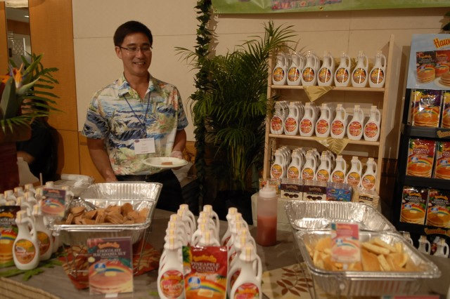 Earl Kuisu, with Hawaiian Sun, displays the company's newest product line, which includes flavored pancakes like chocolate macadamia nut, lilikoi and pineapple, and syrups like lilikoi and guava during the ALA Food Show.