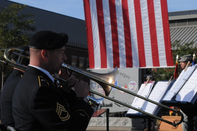 """A member of the 10th Mountain Division (LI) Band plays """"All is well with my soul"""" at the end of the 9/11 memorial ceremony."""