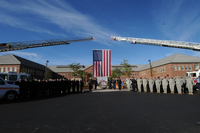 Soldiers, emergency personnel, family members and civilian employees gathered Tuesday in front of the 9/11 Memorial in front of Clark Hall for the annual 9/11 memorial ceremony.