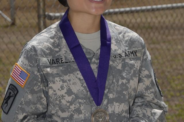 Army JROTC Cadet Juvie Ignacio Varela, sixth recipient of the Lt. Nainoa Hoe Scholarship of Honor, displays the scholarship's accompanying medal during a ceremony, here, Aug. 31.