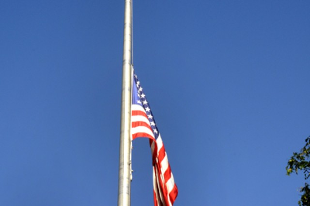 Honor guard members lowered the flag to half staff during the Detroit Arsenal Patriot Day ceremony Sept. 11.