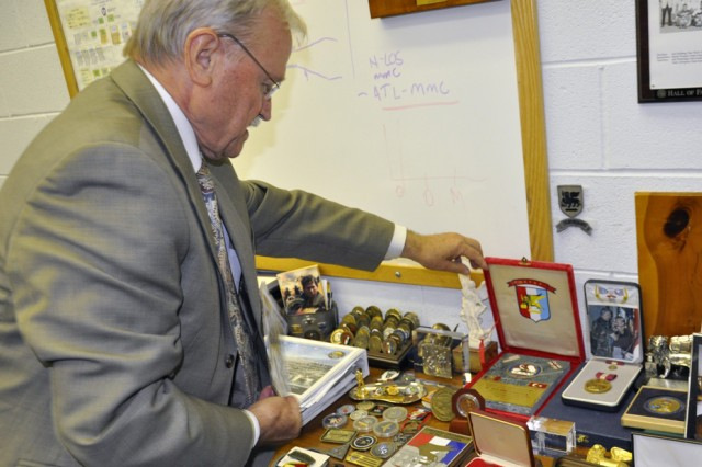 What this photo could not capture is the strong sense of pride that Dr. Guiliano D'Andrea has from the more than 50 years of awards and coins that were on display.  Each award on this table represented some form of support to the warfighter.
