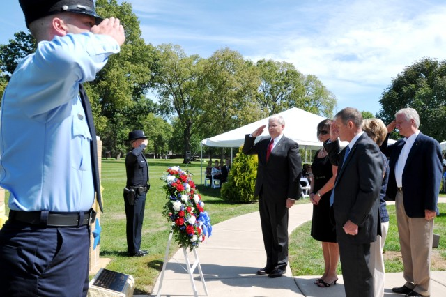 Retired Brig. Gen. Brian Layer (center), former Army Sustainment Command deputy commanding general, and Joel Himsl, Rock Island Arsenal garrison manager, along with Teri Johnson, Annie Cox, and David Pautsch, pay respect to the wreath representing all who have died as a result of the Sept. 11, 2001, attacks. Johnson, Cox, and Pautsch are Gold Star family members. (Photo by Jon Connor, ASC Public Affairs)