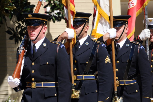 Soldiers of the 3rd U.S. Infantry march the colors into the 9/11 remembrance ceremony in the Pentagon courtyard, Sept. 11, 2012.