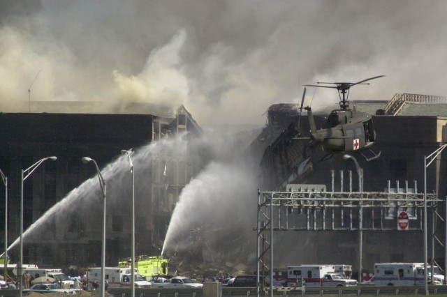 A medevac helicopter hovers near the burning Pentagon on Sept. 11, 2001 as firefighters try to extinguish the blaze caused by the aircraft slamming into the building.
