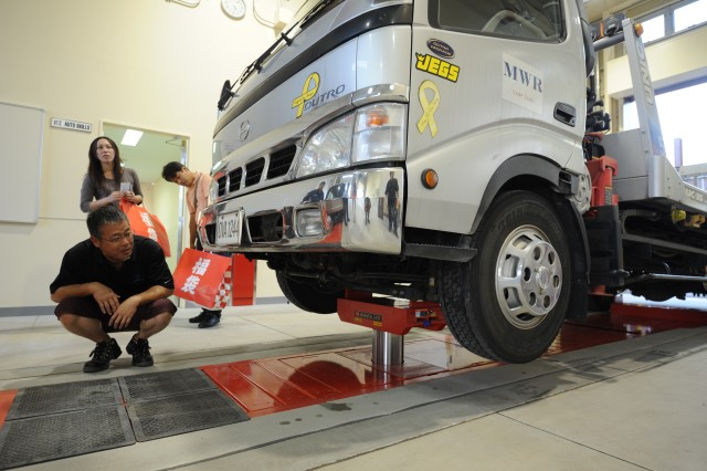 The new Auto Skills Center has a hydraulic lift as one of its vehicle maintenance services.