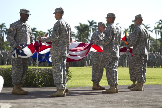 Members from the flag detail fold the American flag during a 9/11 Remembrance Ceremony, Sept. 9, 2012, at Fort Shafter, Hawaii.